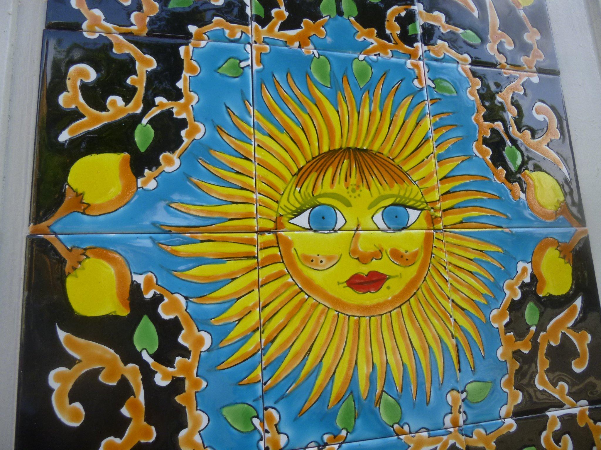 Sonne auf Kacheln